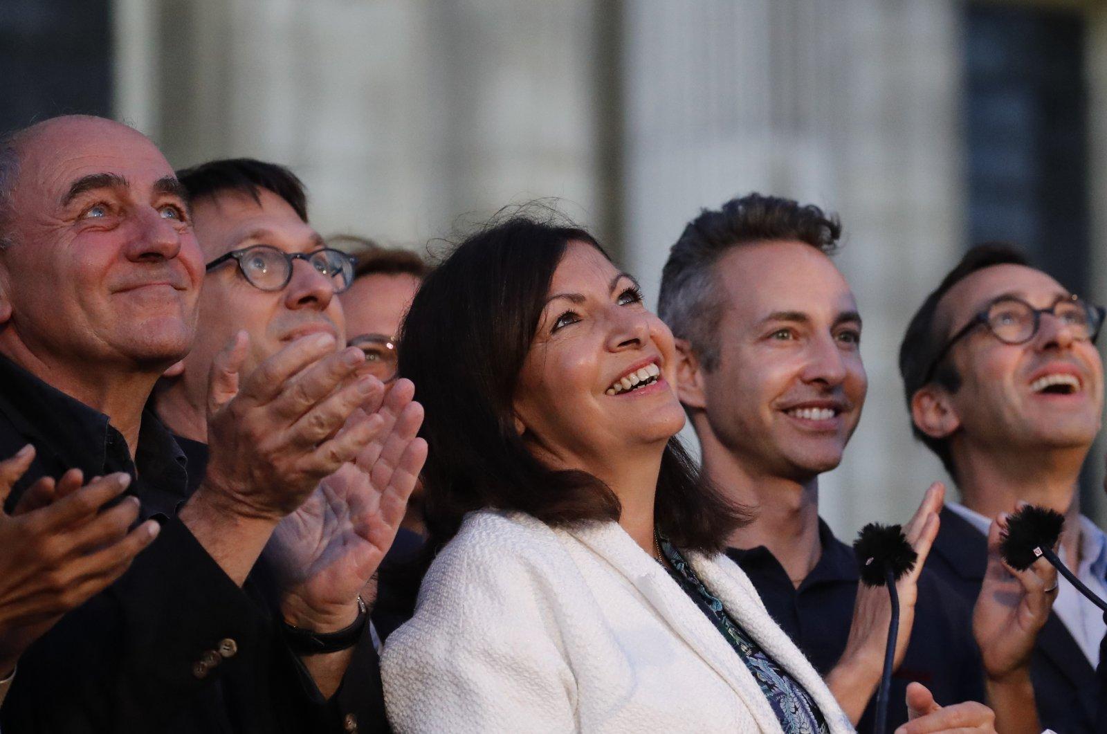 Paris Mayor Anne Hidalgo (C) looks up after her victorious second round of the municipal election, Paris, France, June 28, 2020. (AP Photo)