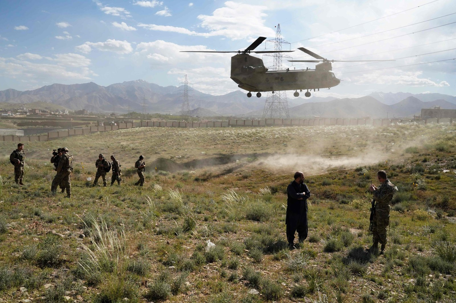 In this June 6, 2019, file photo, a U.S. military helicopter lands on a field outside the governor's palace during a visit by the commander of U.S. and NATO forces in Afghanistan, General Scott Miller, and Asadullah Khalid, acting minister of defense of Afghanistan, in Maidan Shar, capital of Wardak province, Afganistan. (AFP Photo)