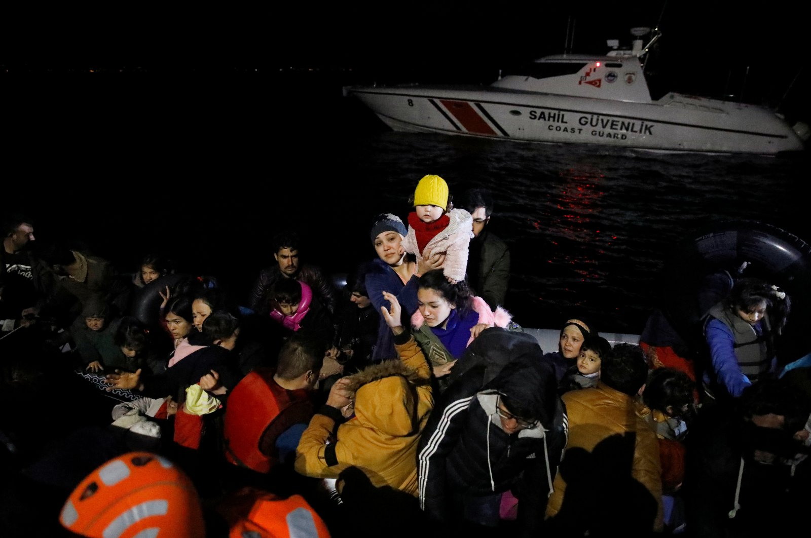 Migrants board a Turkish coast guard vessel following a failed attempt to cross to the Greek island of Lesbos, on the waters of the North Aegean Sea, off the shores of Çanakkale, Turkey, March 6, 2020. (Reuters Photo)