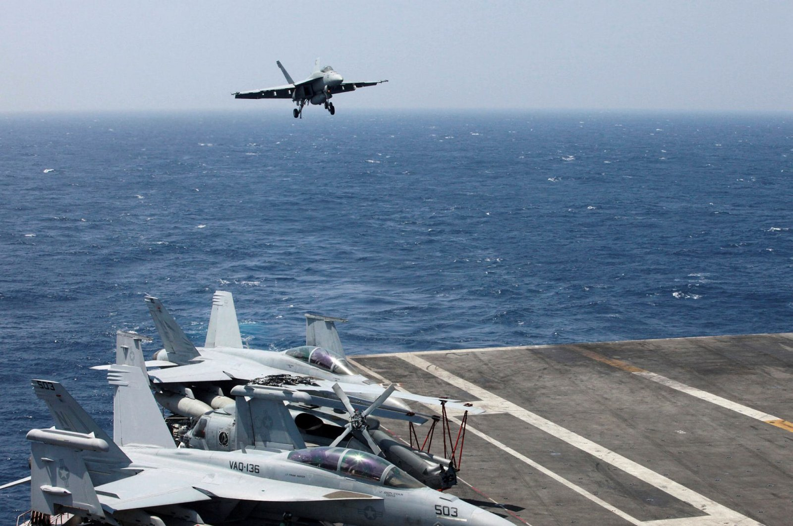 An F-18 fighter jet lands on the U.S Navy aircraft carrier USS Carl Vinson (CVN 70) following a patrol of the disputed South China Sea, March 3, 2017. (AP Photo)
