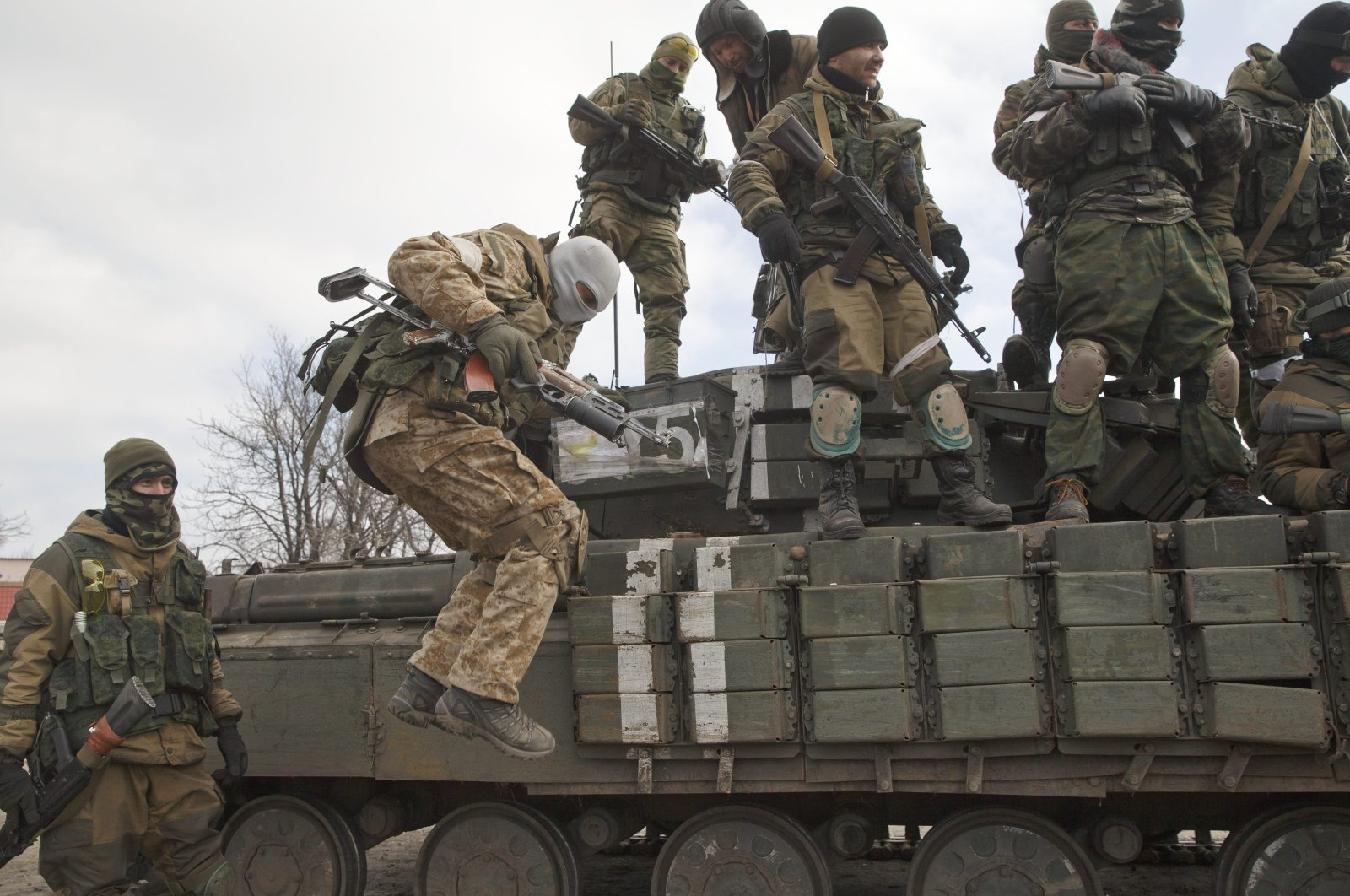 A Russia-backed rebel jumps off a tank in Donetsk, Ukraine, February 20, 2015. (AP Photo)