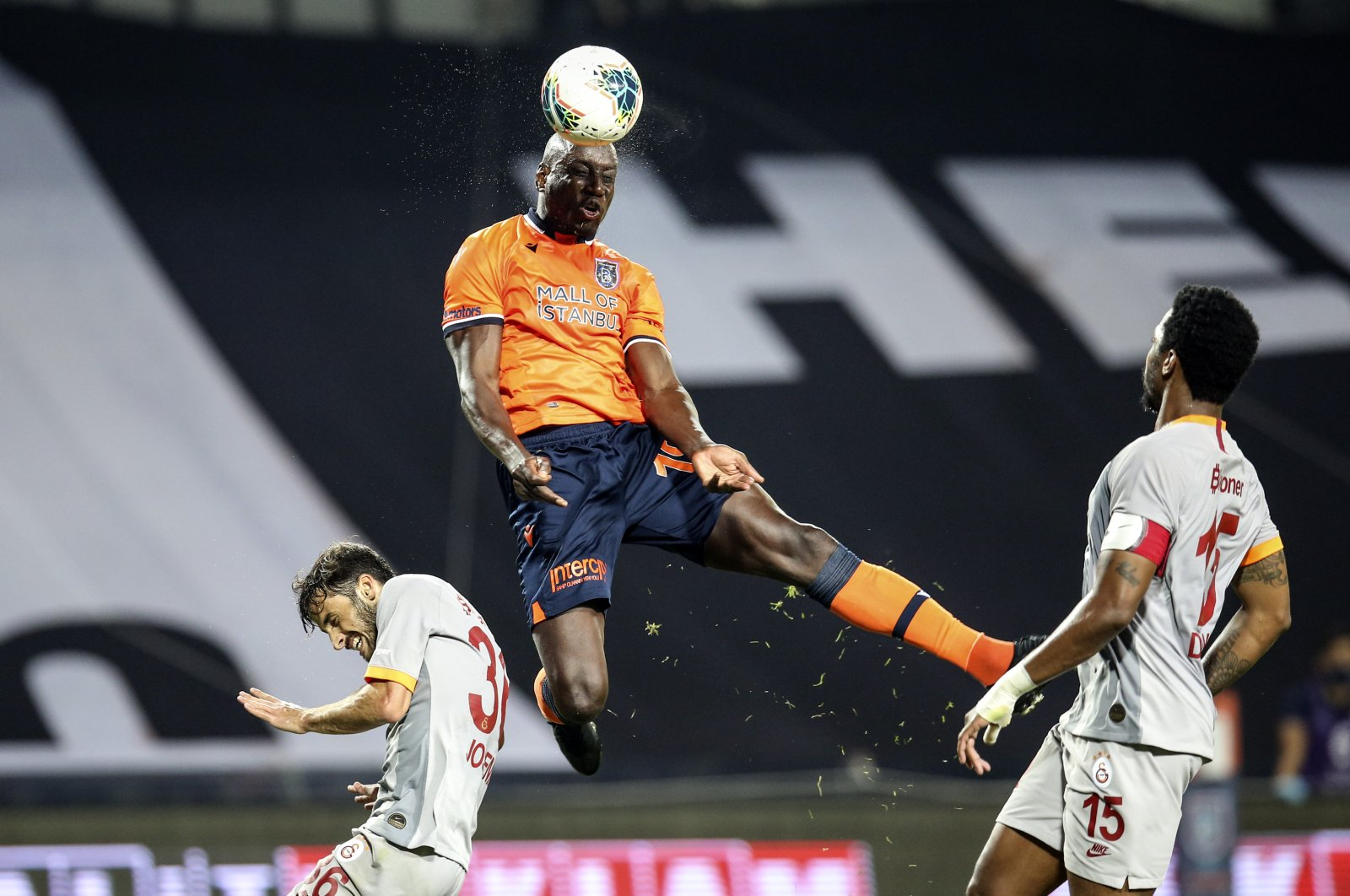 Başakşehir's Demba Ba (C) confronts Galatasaray's Ryan Donk (R) and Marcelo Saracchi (L) during the match in Istanbul, Turkey, June 28, 2020. (AA Photo)