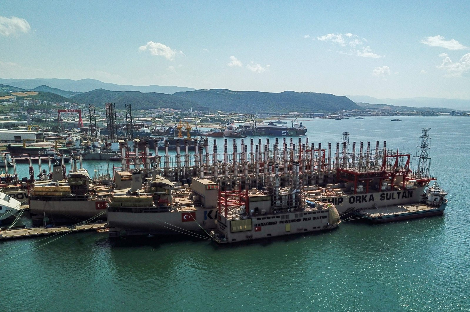 The powerships Orca Sultan (front) and Raif Bey (back) are seen docked in a shipyard in Altinova district, Yalova, Turkey, June 16, 2020. (AFP Photo)