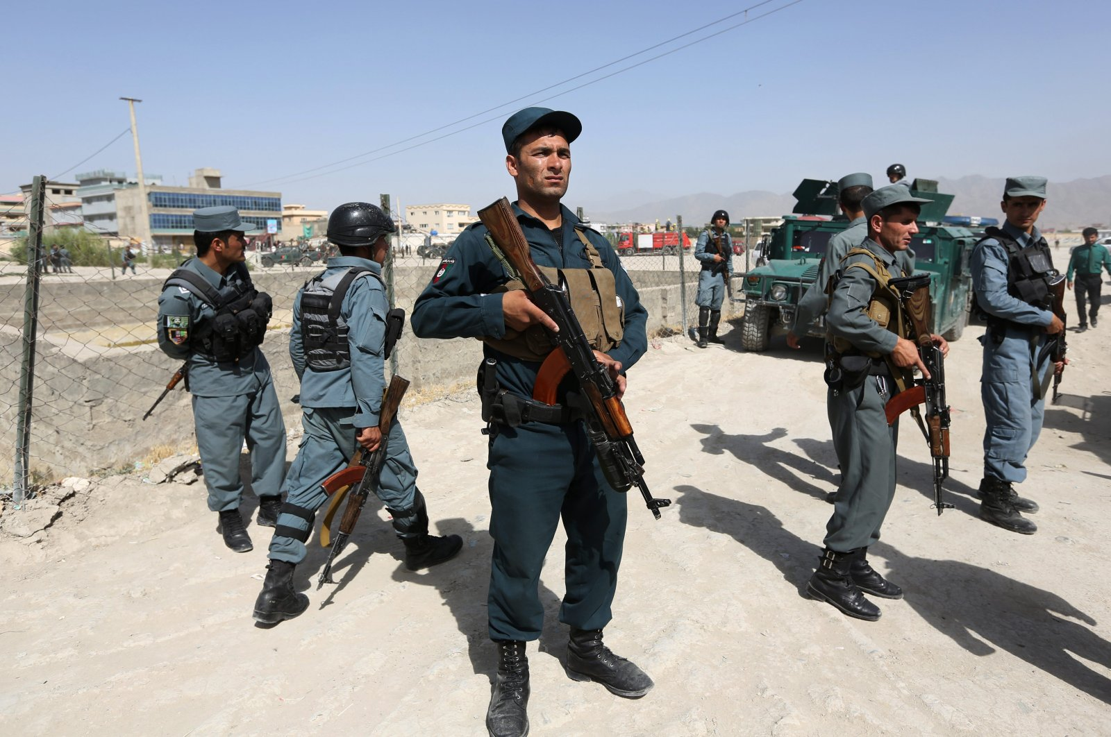 Afghan security forces inspect the site of a suicide attack after clashes with Taliban fighters at the gate of an intelligence facility in Kabul, Afghanistan, July 7, 2015. (AP File Photo)