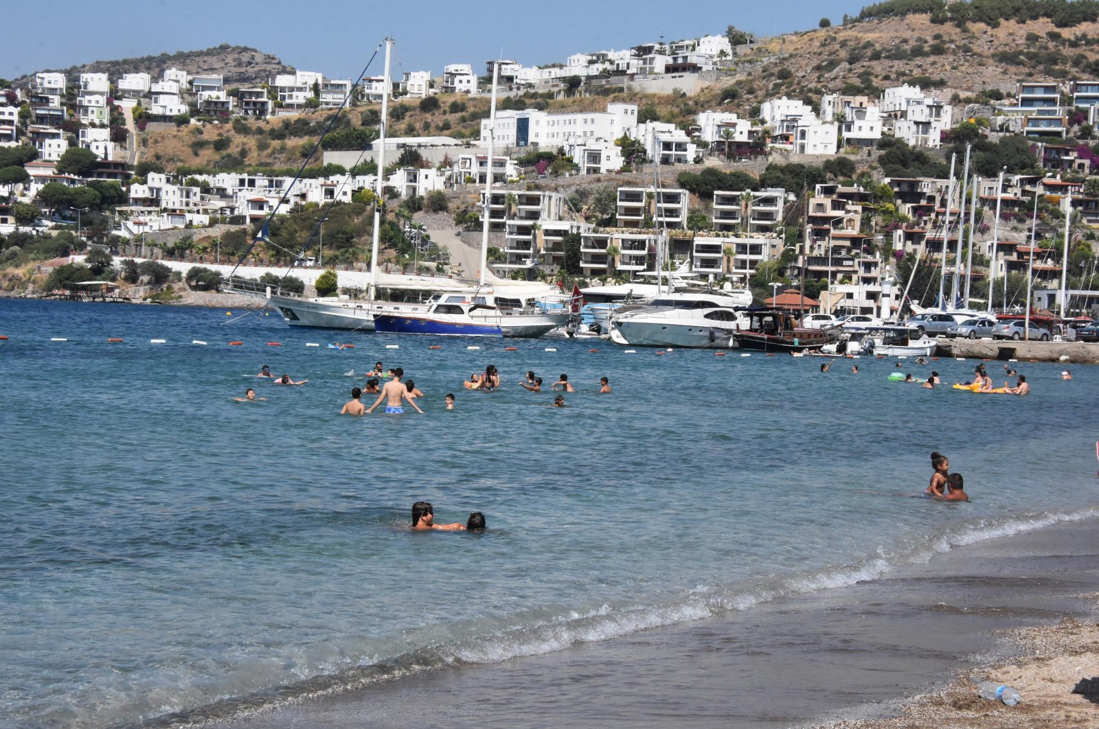 People swimming by a beach in Bodrum, in Muğla, Turkey, June 28, 2020. (DHA Photo)