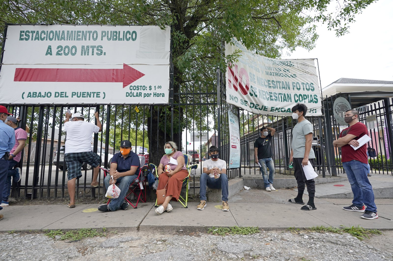 People wait in line at a free COVID-19 testing site at the Mexican Consulate, Houston, Texas, June 28, 2020. (AP Photo)