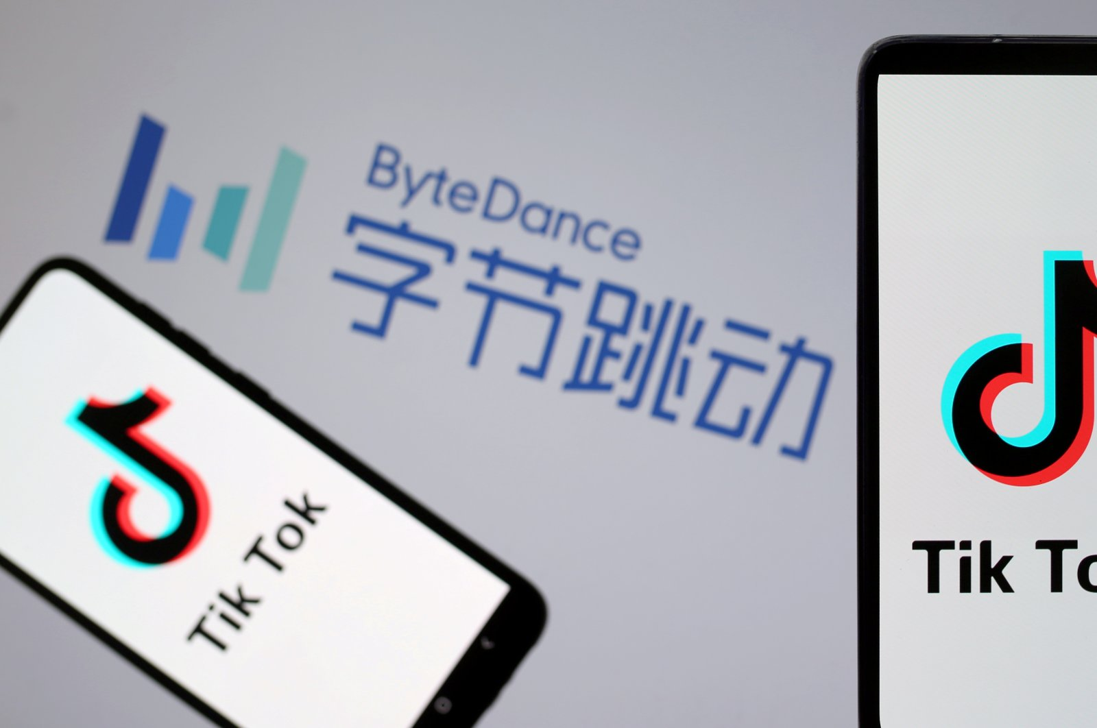 TikTok logos are seen on smartphones in front of a displayed ByteDance logo in this illustration taken Nov. 27, 2019. (Reuters Photo)
