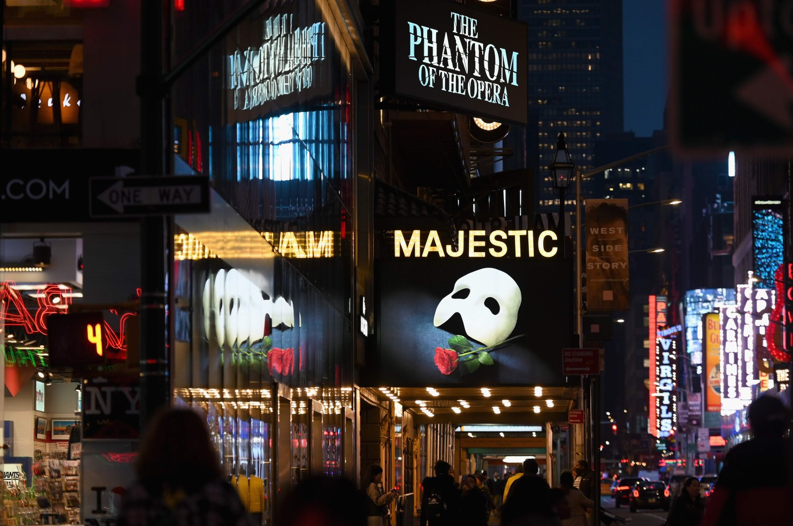 """In this file photo signage of the Broadway play """"The Phantom of the Opera"""" is seen at Time Square, New York City, U.S. March 12, 2020 (AFP Photo)"""