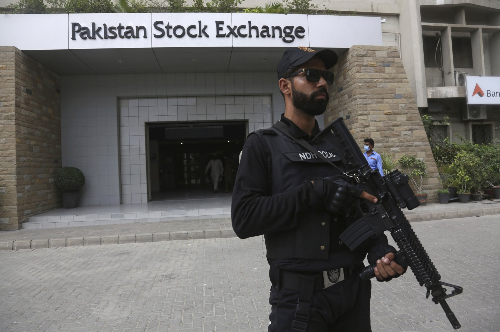 A police commando stands guard outside the Pakistan Stock Exchange after an attack in Karachi, Pakistan, June 29, 2020. (AP Photo)