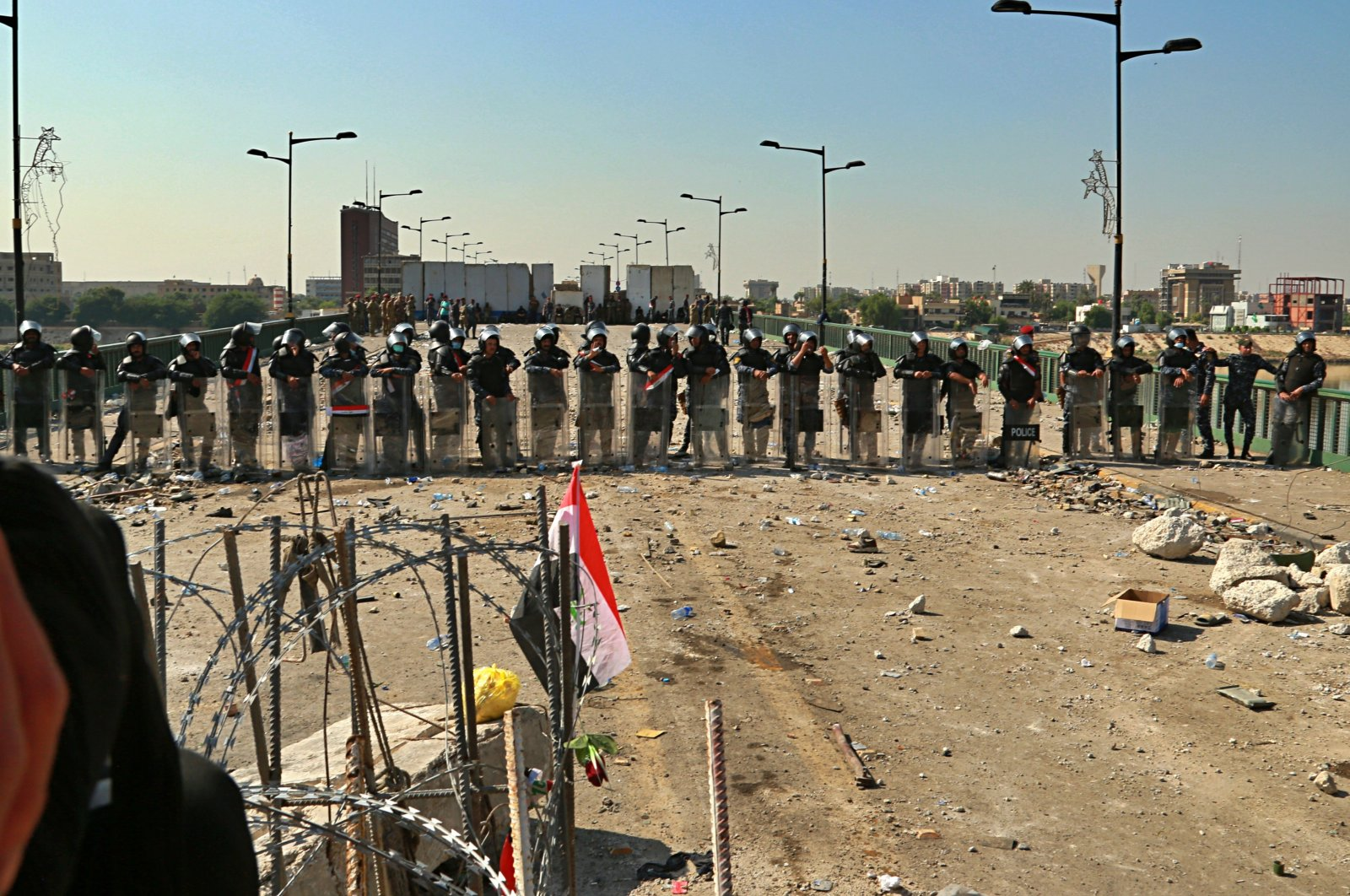 Security forces close the bridge leading to the Green Zone during a demonstration in Baghdad, Iraq, Saturday, Oct. 26, 2019. (AP Photo)