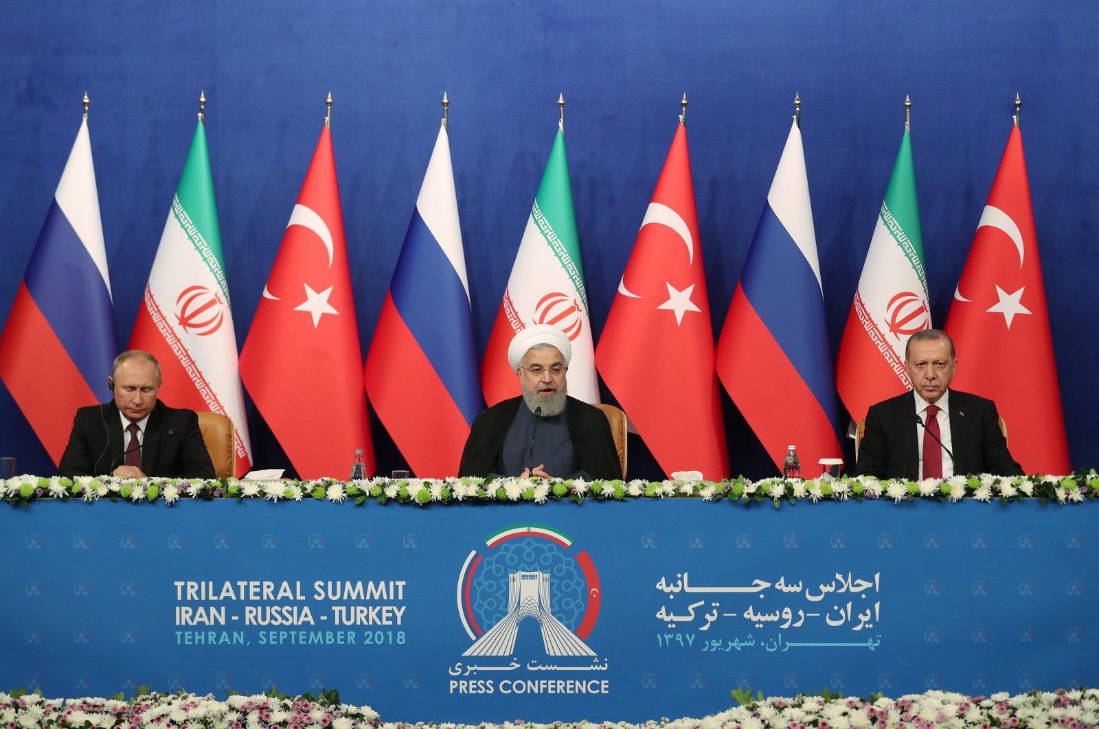 Russian President Vladimir Putin (L), Iranian President Hassan Rouhani (C) and President Recep Tayyip Erdoğan attend a trilateral summit in Tehran, Iran, Sept. 8, 2019. (AA File Photo)