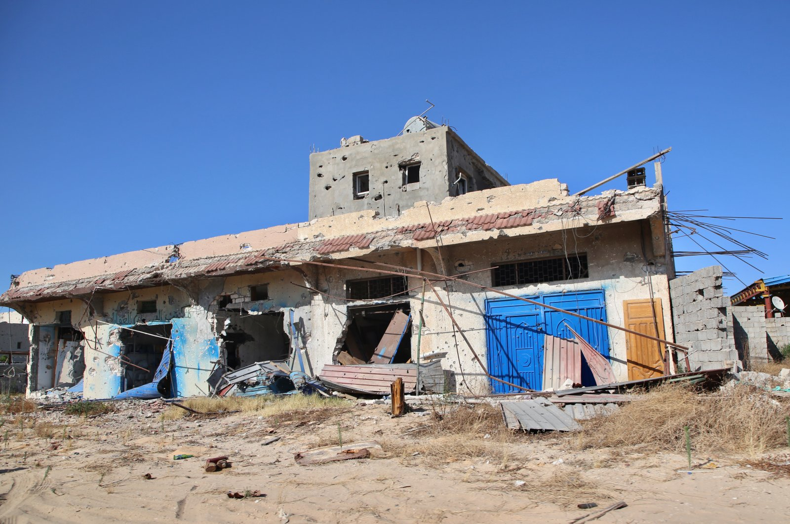 Forces loyal to putschist Gen. Khalifa Haftar leave demolished towns behind as they retreat from the southern suburbs of the capital Tripoli, June 27, 2020. (AA Photo)