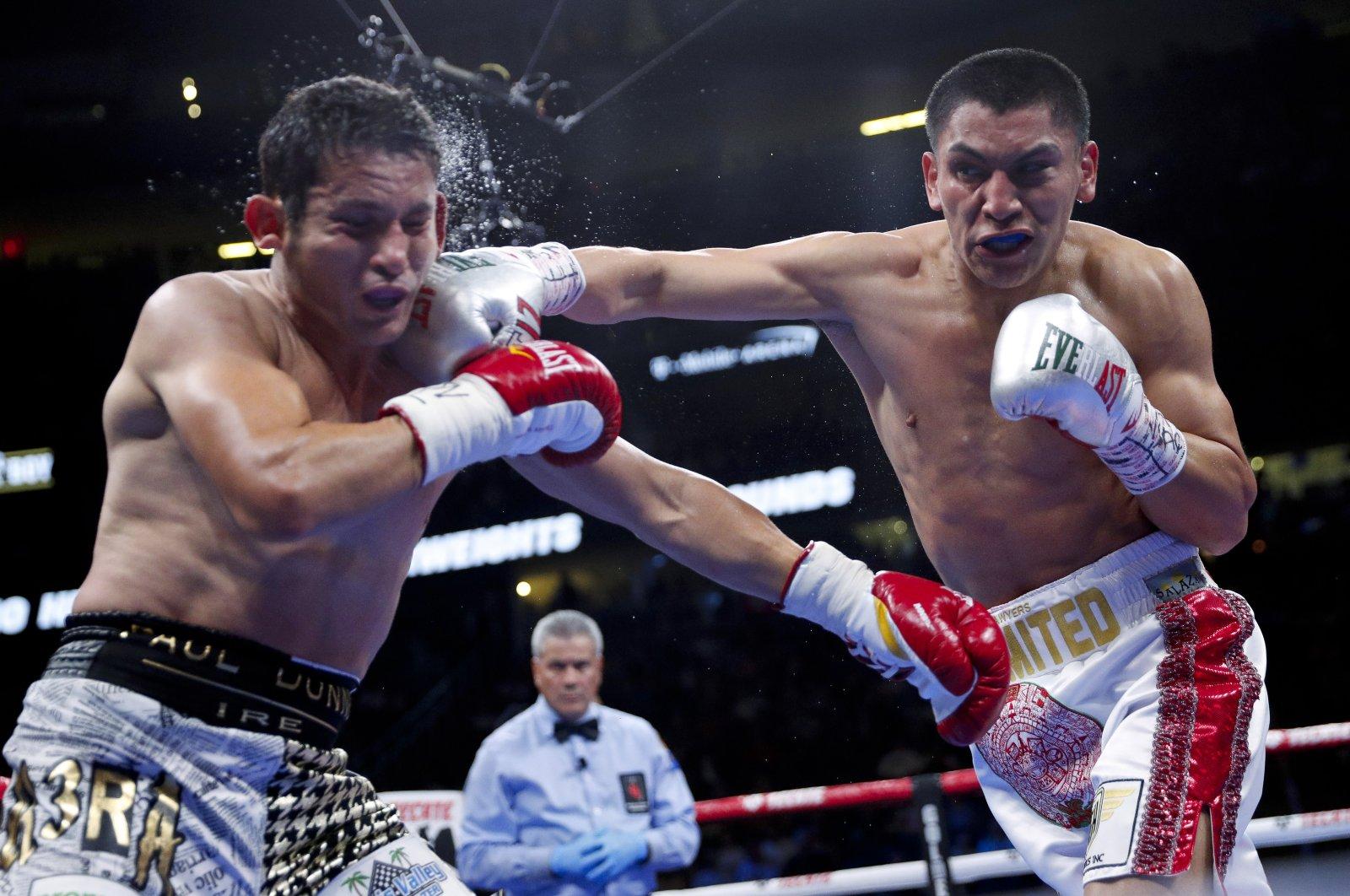 Vergil Ortiz Jr. (R) hits Mauricio Herrera during a welterweight boxing match in Las Vegas, U.S., May 4, 2019. (AP Photo)