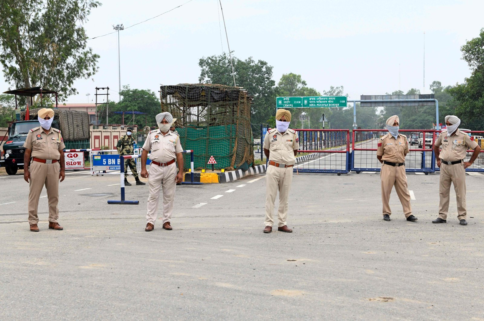 Indian police personnel stand guard near India-Pakistan Wagah border post, June 25, 2020. (AFP Photo)
