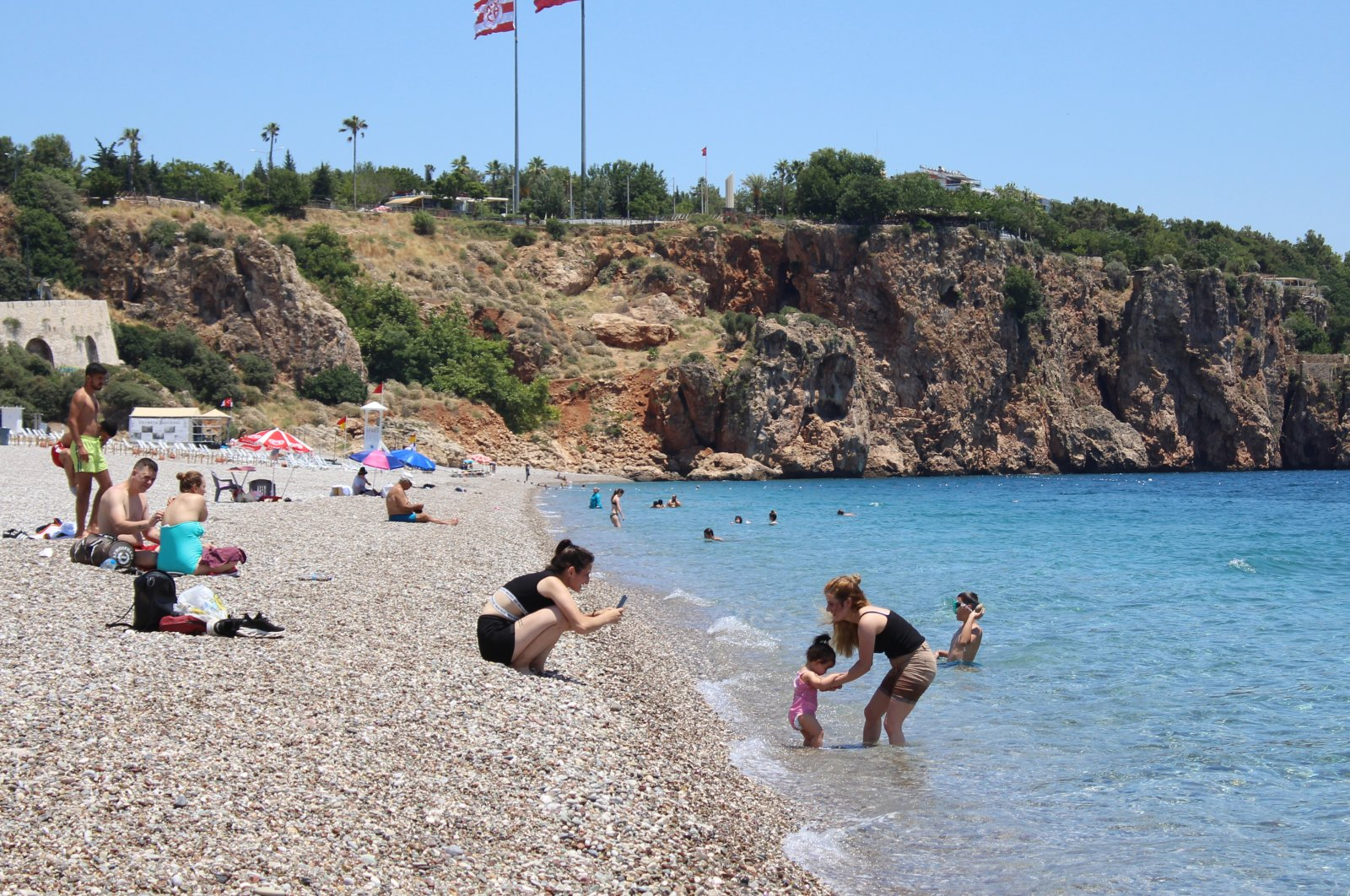 People swim and sunbathe in Antalya, Turkey, June 28, 2020. (DHA Photo)
