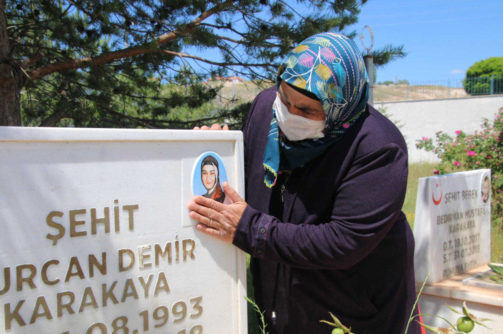 Suudiye Demir visits her daughter's grave following the news that her killer, PKK terrorist, has been killed, June 30, 2020. (AA)
