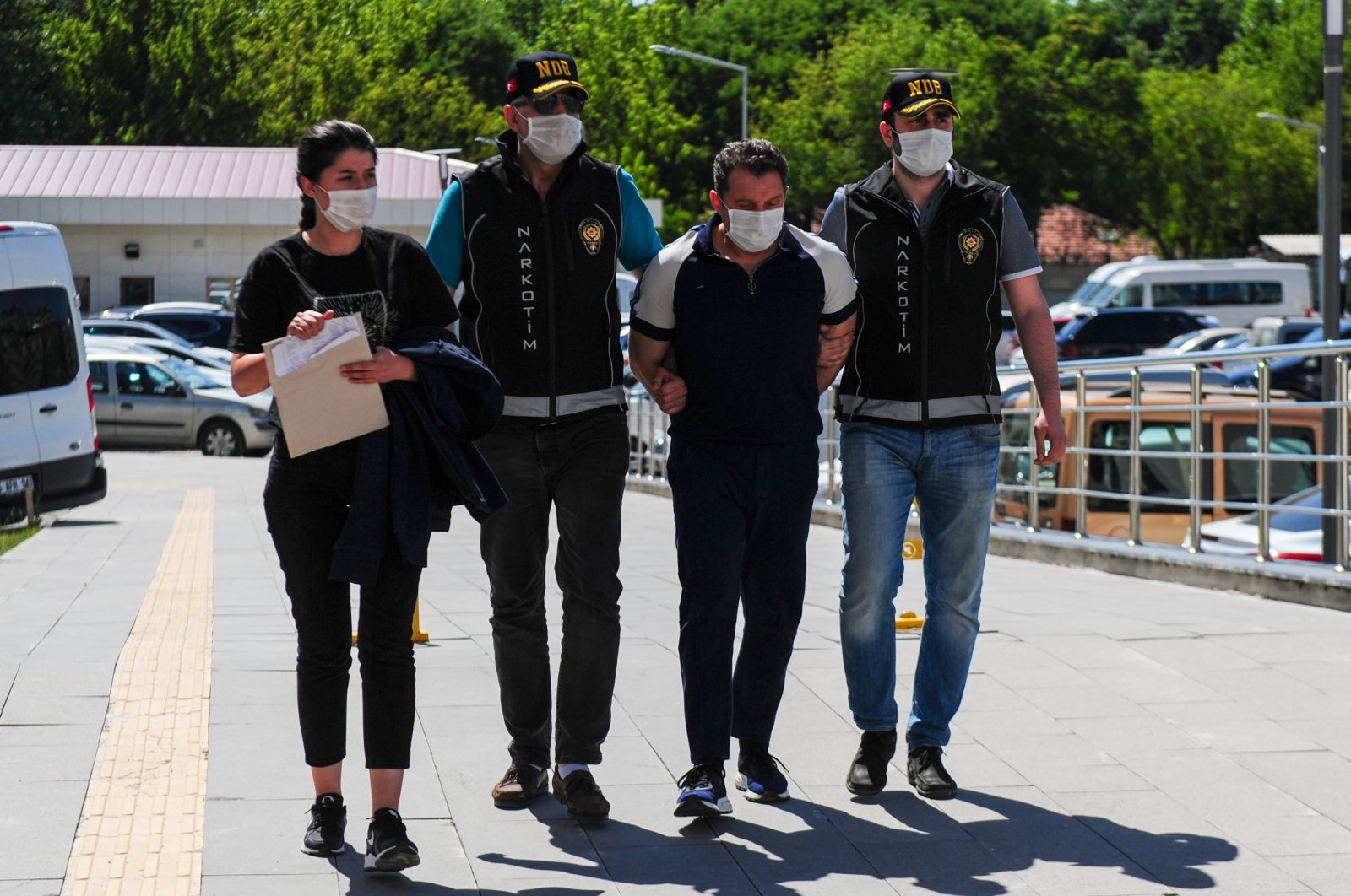Police officers escort Nejat Daş, one of the suspects, to the police headquarters, in Ankara, Turkey, June 30, 2020. (İHA Photo)