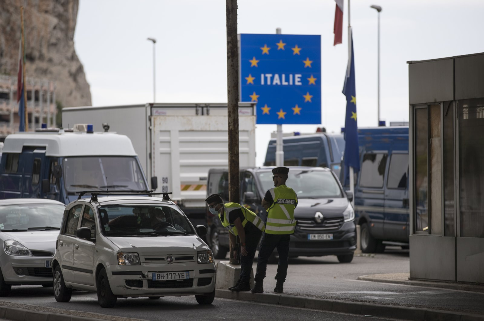 In this Monday, June 15, 2020 file photo, French gendarmes approach a car at the Saint-Ludovic border check point on the Franco-Italian border in Menton, France. (AP Photo)