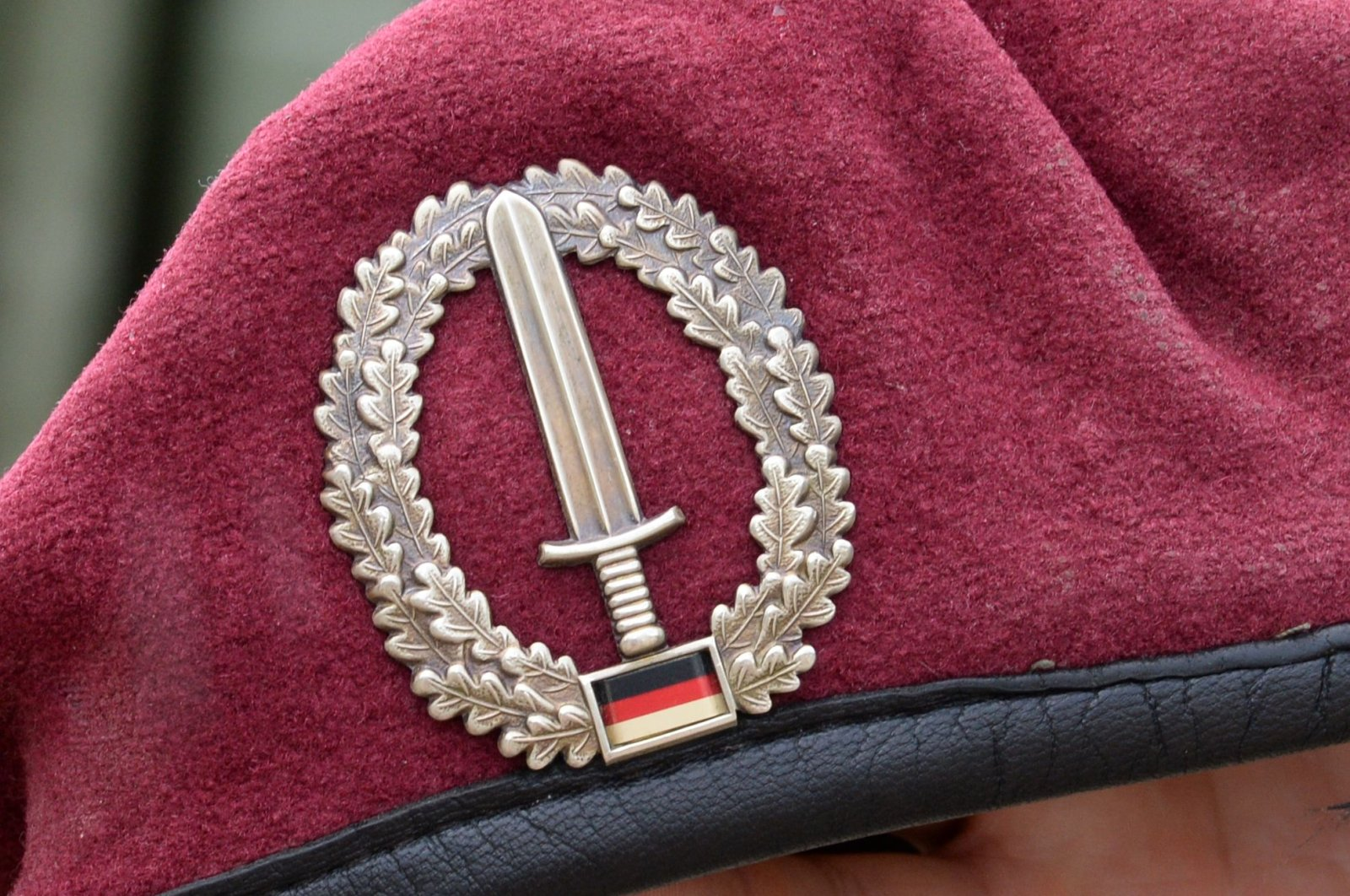 Picture taken on July 14, 2014 shows the emblem of the KSK (Kommando Spezialkraefte) special unit of Germany's armed forces Bundeswehr seen on the beret of a soldier taking part in a military exercise in Calw near Sindelfingen, southern Germany. (AFP Photo)