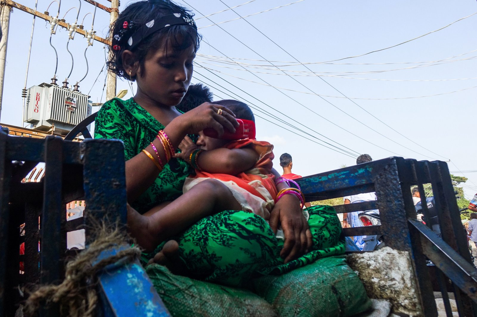 A girl holds a baby at the Aung Mingalar segregation quarter for Rohingya Muslims, Indonesia, May 24, 2020, (AFP Photo)