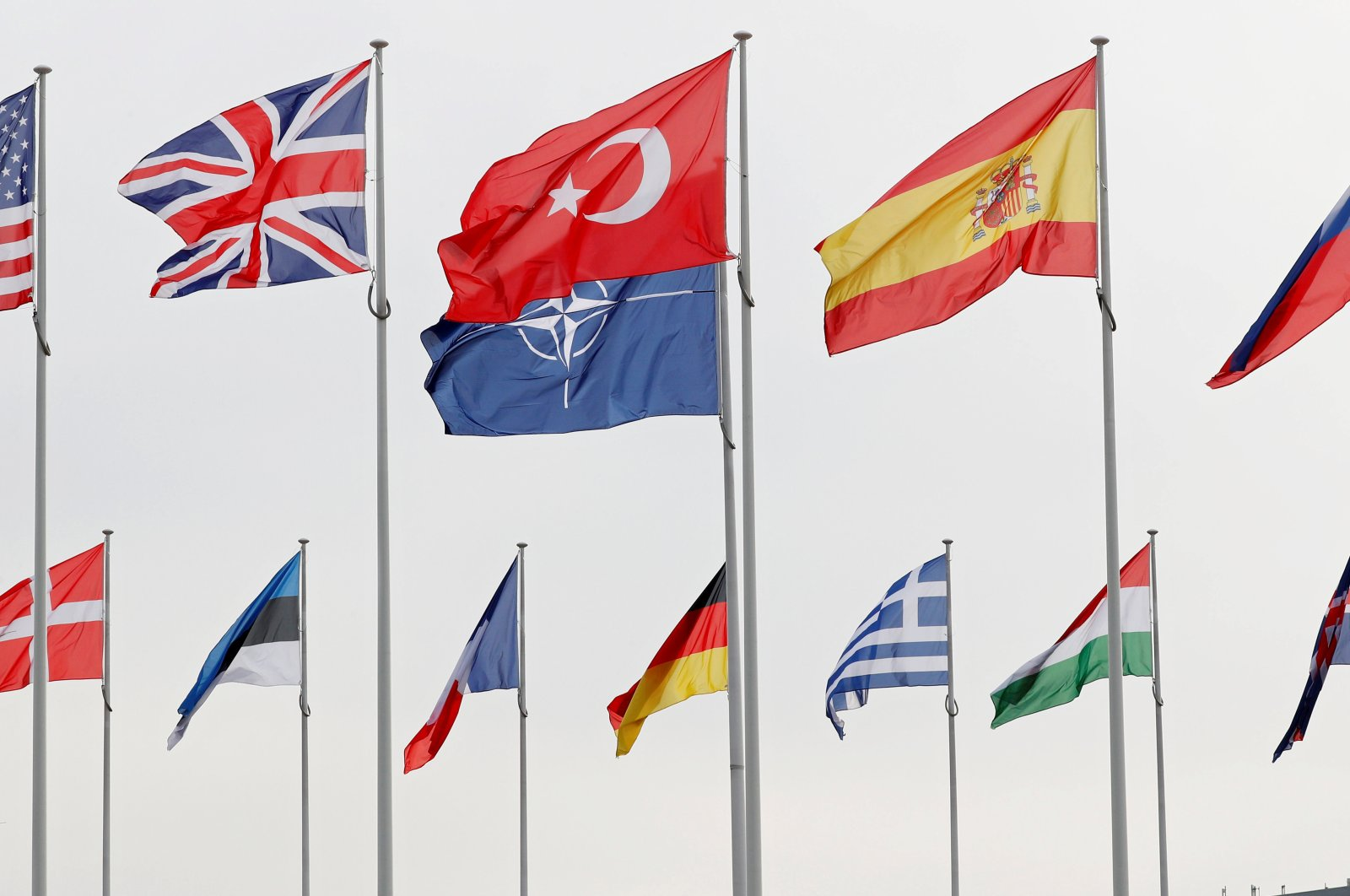 Flags of NATO member countries flutter at the alliance headquarters in Brussels, Feb. 28, 2020.  (Reuters Photo)