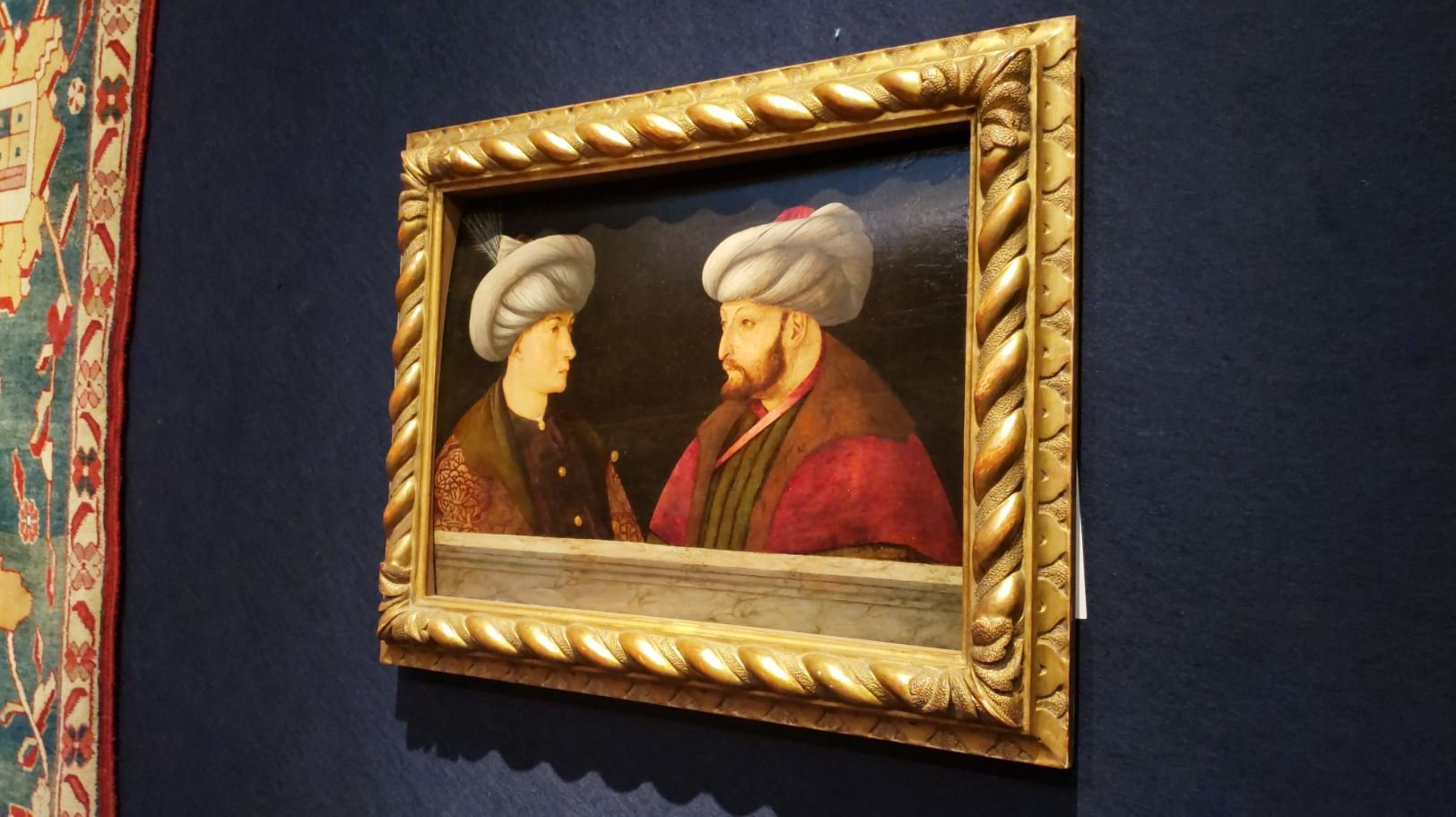 The purchased painting of Sultan Mehmed II hangs on a wall. (DHA Photo)