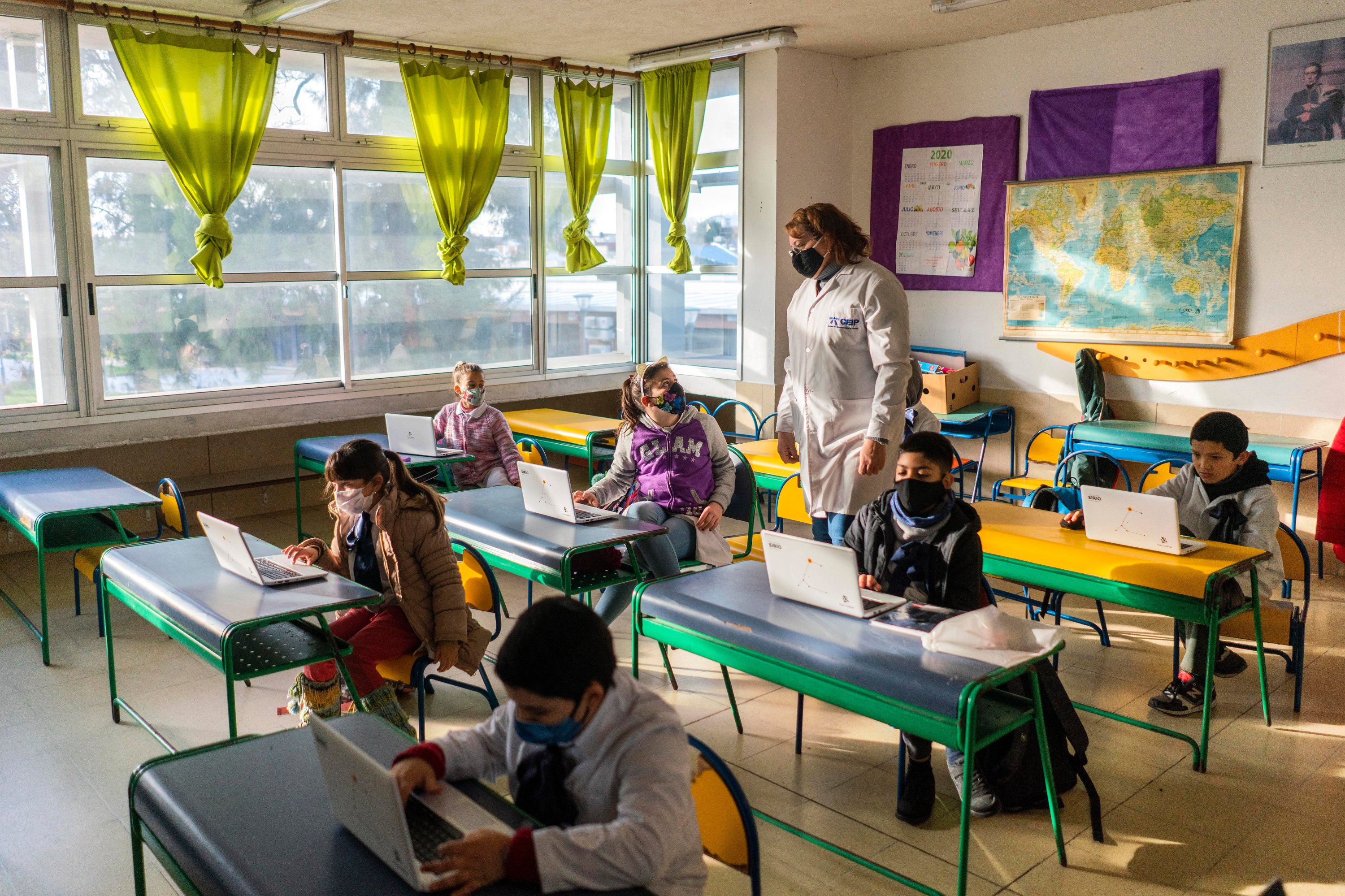 Students wearing protective face masks as a measure to curb the spread of the new coronavirus, attend class in a public school in Montevideo, Uruguay, Monday, June 15, 2020. (AP Photo)