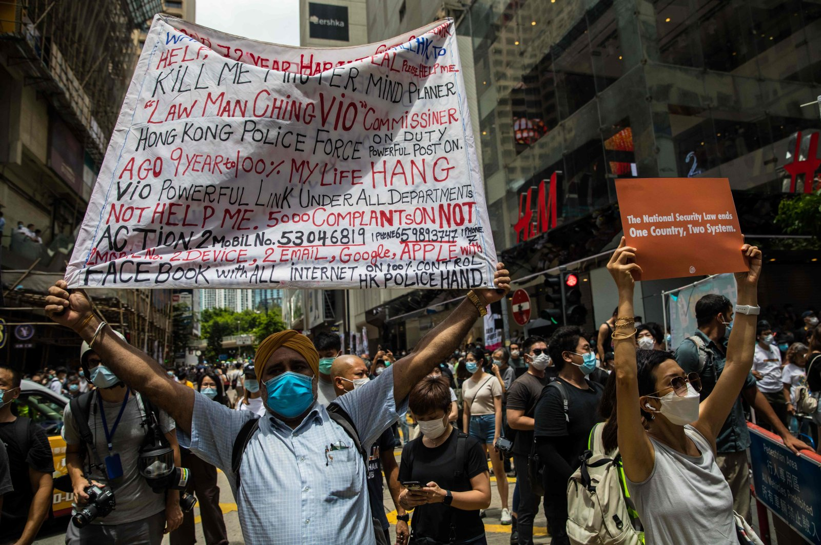 Protesters display banners during a rally against a new national security law in Hong Kong on July 1, 2020, on the 23rd anniversary of the city's handover from Britain to China. (AFP Photo)