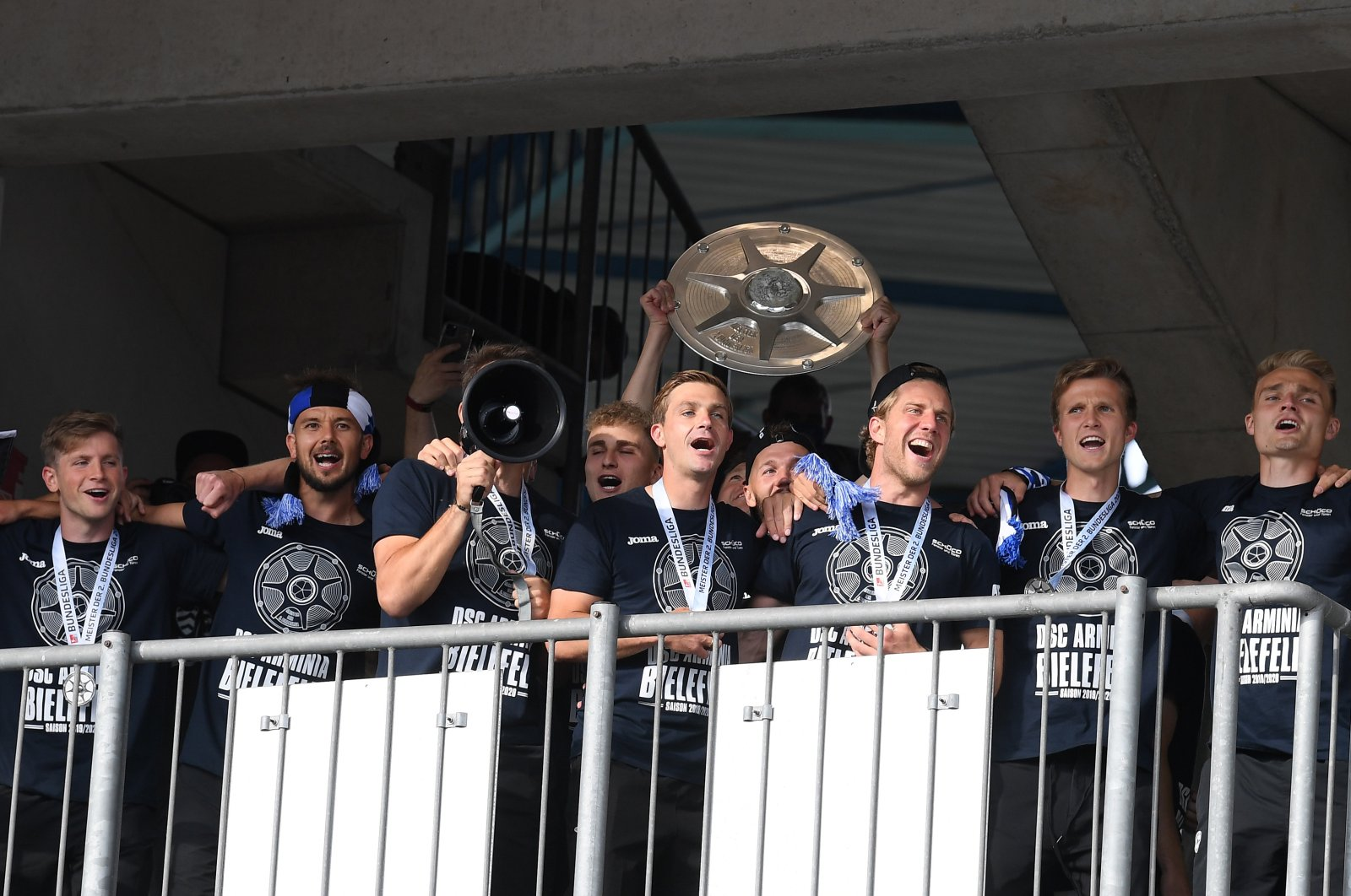 Players of Bielefeld celebrate with the championship trophy after the German Bundesliga Second Division match between DSC Arminia Bielefeld and FC Heidenheim 1846 in Bielefeld, Germany, June 28, 2020. (EPA Photo)