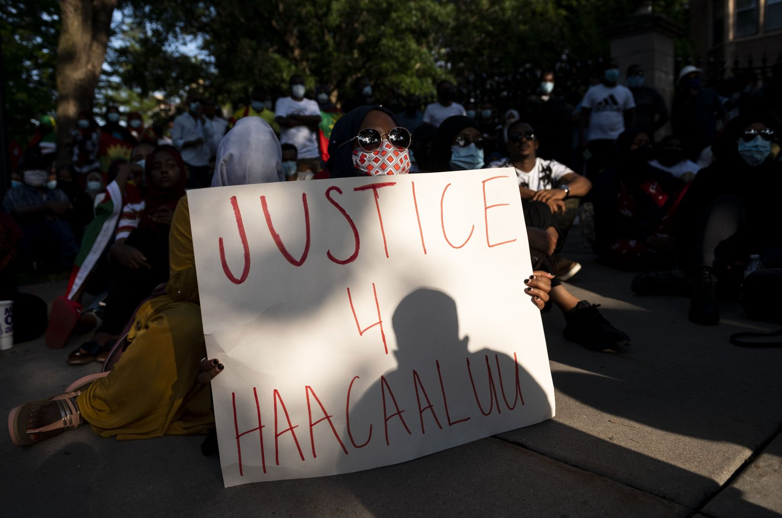 People gather during a protest of the death of musician and activist Haacaaluu Hundeessaa outside the Governor's Mansion in St. Paul, Minnesota, U.S., June 30, 2020. (AFP Photo)