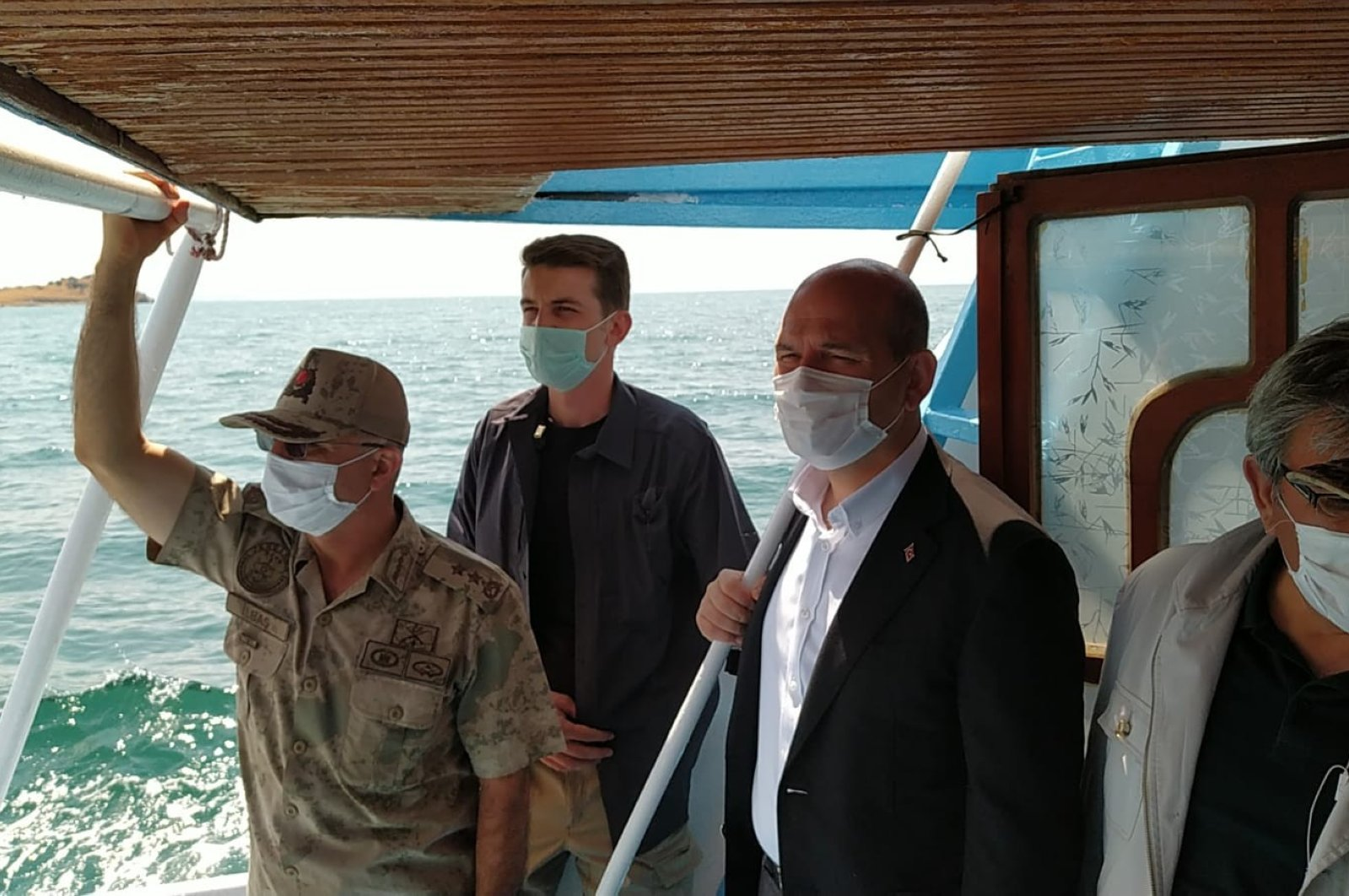Interior Minister Süleyman Soylu (R), inspects the rescue work in Lake Van following the sinking of a migrant boat, July 1, 2020. (IHA)