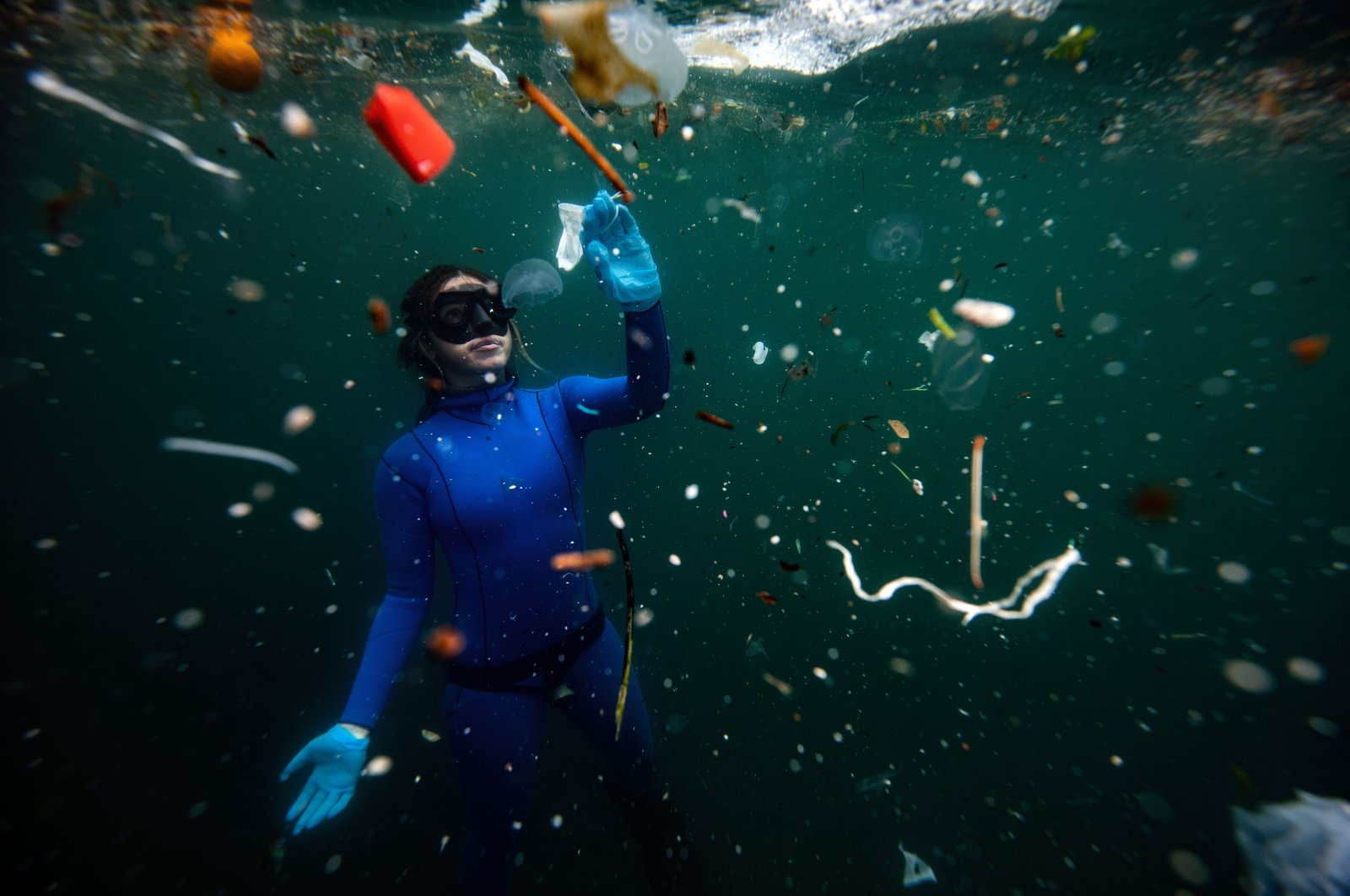 Şahika Ercümen's dive drew attention to the extent of the plastic waste pollution in our waters. (AA Photo)