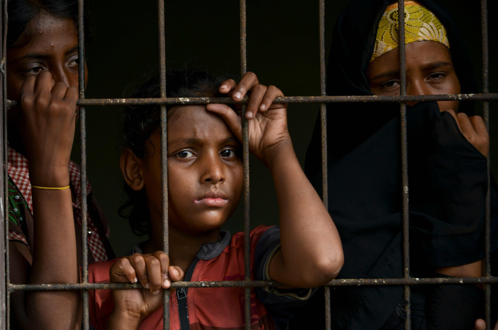 Rohingya from Myanmar look through a fence at the immigration detention center in Lhokseumawe, in Indonesia's North Aceh Regency, June 26, 2020. (AFP Photo)