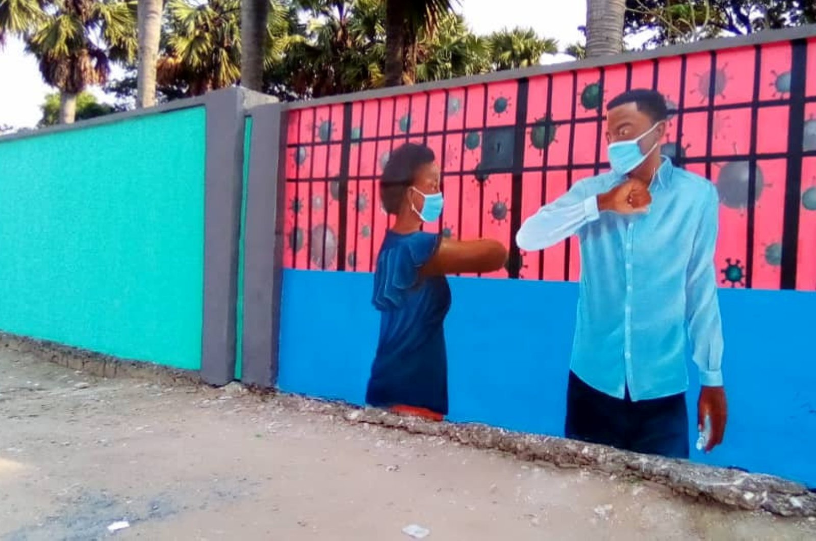 A wall mural depicts an advocacy message on greetings as a measure against coronavirus disease (COVID-19) outbreak, on the walls of the Kinshasa Academy of Fine Arts in Kinshasa, Democratic Republic of Congo, June 22, 2020. (REUTERS PHOTO)