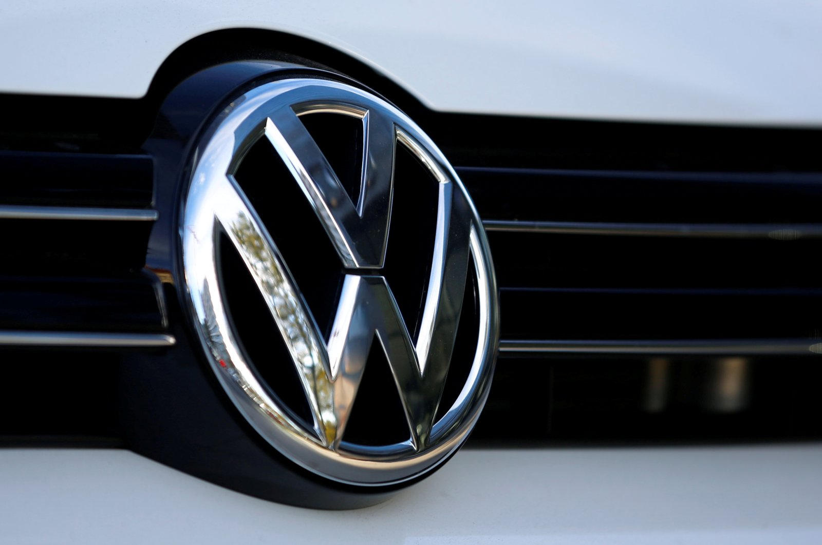 The logo of German carmaker Volkswagen is seen on a car outside a garage in Vienna, Austria, Sept. 29, 2016. (Reuters Photo)