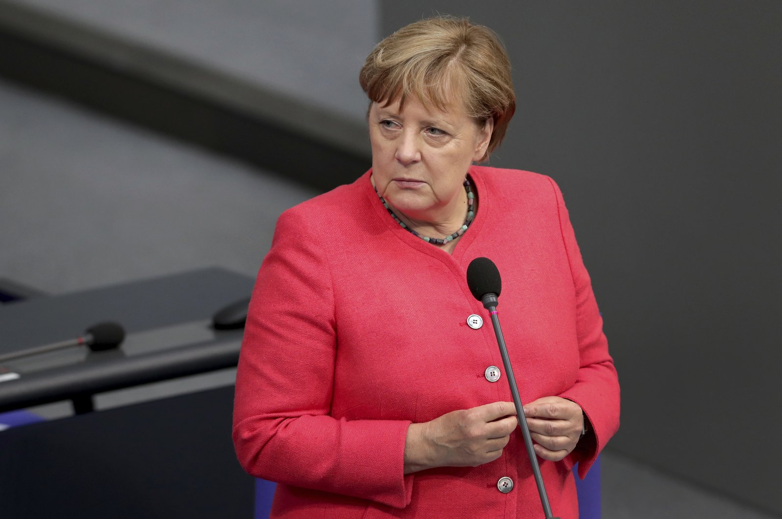 German Chancellor Angela Merkel takes questions from a deputy of the far-right Alternative for Germany party during a meeting of the German federal parliament, the Bundestag, at the Reichstag building, Berlin, Germany, July 1, 2020. (AP Photo)