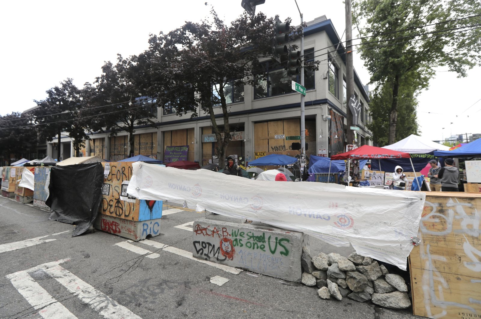 Cement barricades are fortified with chunks of concrete and tarps in front of the Seattle Police Department East Precinct building at the Capitol Hill Occupied Protest zone in Seattle, Washington, U.S., June 30, 2020. (AP Photo)
