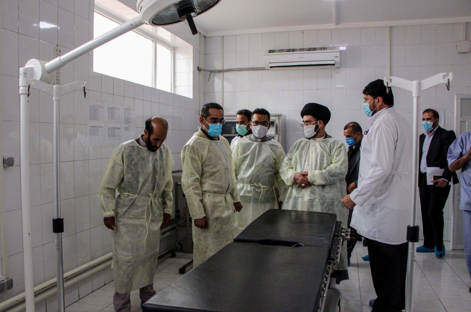Afghanistan's Health Minister Ahmad Jawad Osmani (2L) visits maternity rooms during the inauguration reopening ceremony of a medical ward at MSF Hospital, Kabul, July 1, 2020. (AFP Photo)
