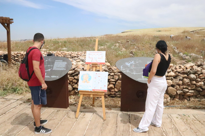 Two visitors are seen at the Göbeklitepe archaeological site in Şanlıurfa, southeastern Turkey, July 1, 2020. (AA PHOTO)
