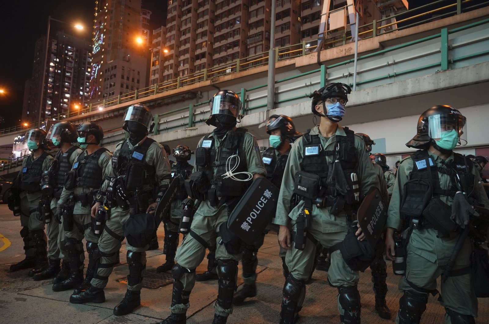 Riot police stand guard after pushing back protesters demonstrating against the new security law during the anniversary of the Hong Kong handover from Britain, Wednesday, July. 1, 2020, in Hong Kong. (AP Photo)