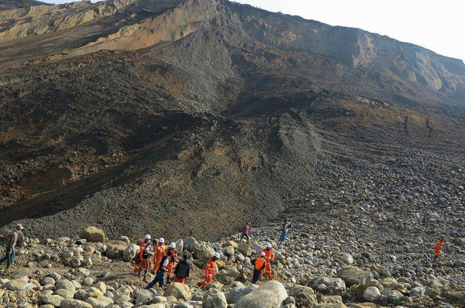 In this Dec. 26, 2015, file photo, rescue workers are seen at the site of a landslide at a jade mine in Hpakant, Kachin State, Myanmar. (AFP Photo)