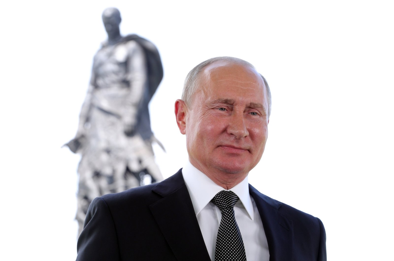 President Vladimir Putin appears in a televised address to the nation in Khoroshevo, the Tver region, with a monument to World War II Red Army soldiers seen in the background, Russia, Tuesday, June 30, 2020. (Kremlin Pool Photo via AP)