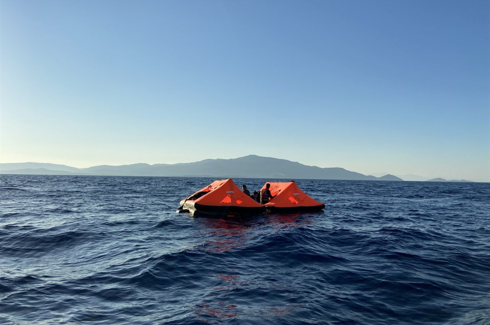 49 asylum-seekers in two rubber rafts were rescued off the coast of the Dikili district in the western province of Izmir, Turkey, July 1, 2020. (AA Photo)