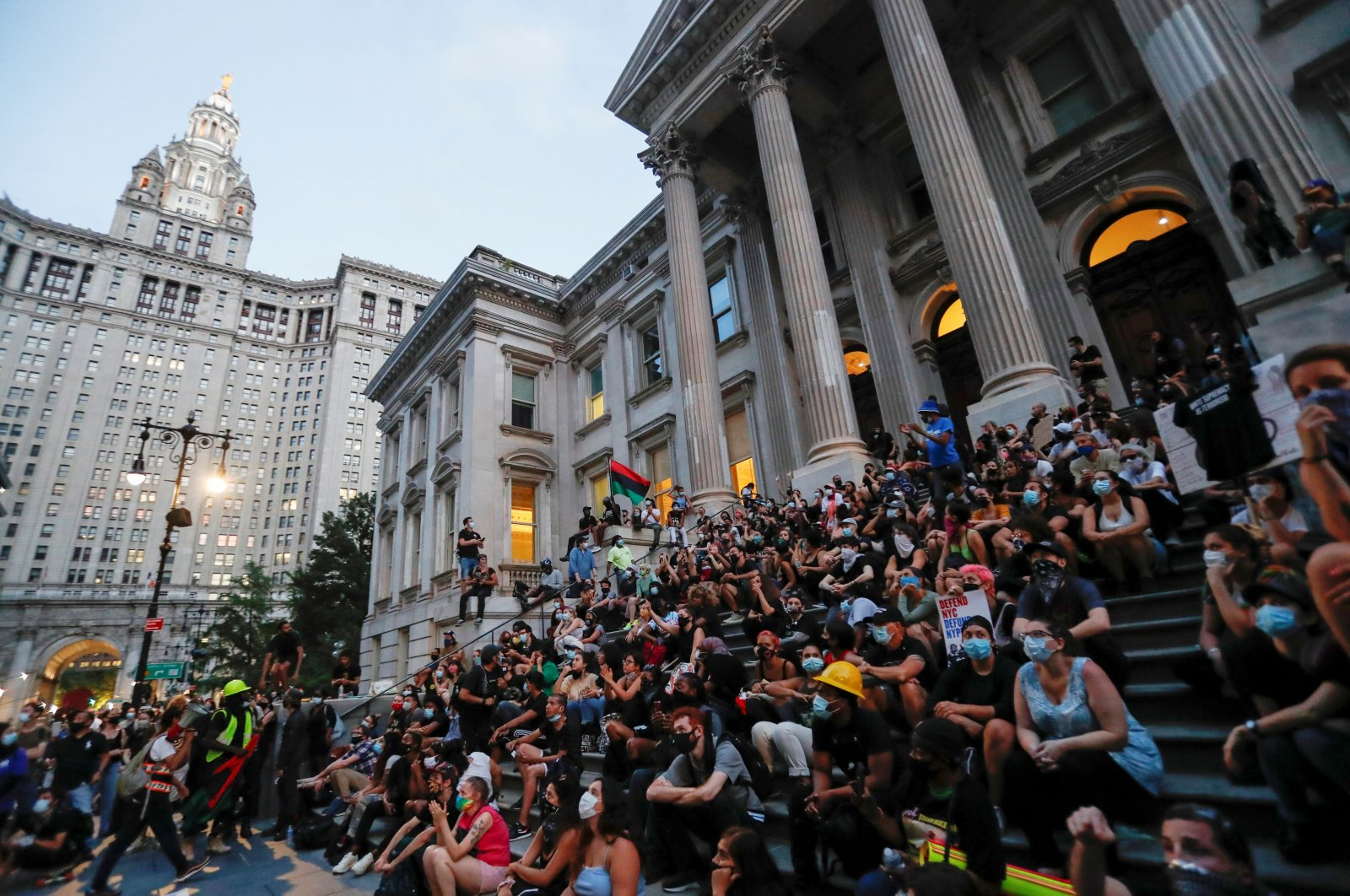 "Demonstrators gather near an area called the ""City Hall Autonomous Zone"" that has been established to protest the New York Police Department, in support of Black Lives Matter, near City Hall in lower Manhattan, in New York City, New York, U.S., June 30, 2020. (Reuters Photo)"