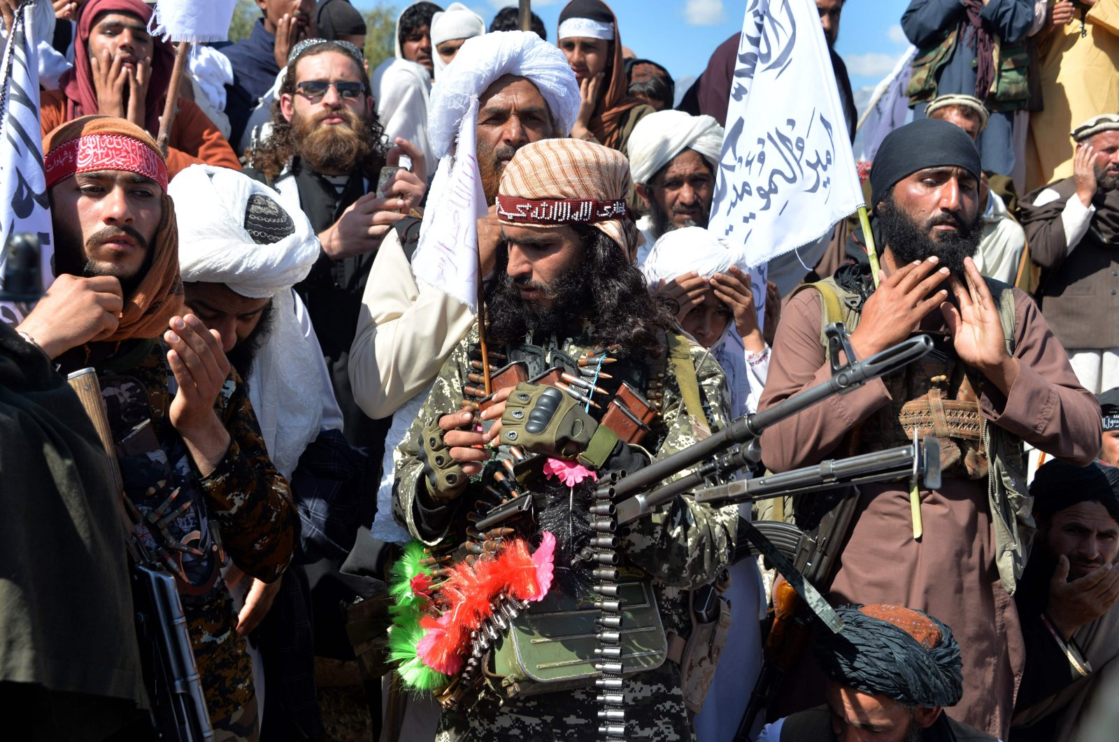Afghan Taliban militants and villagers attend a gathering as they celebrate the peace deal and their victory in the Afghan conflict on U.S. in Afghanistan, in Alingar district of Laghman Province, March 2, 2020. (AFP Photo)