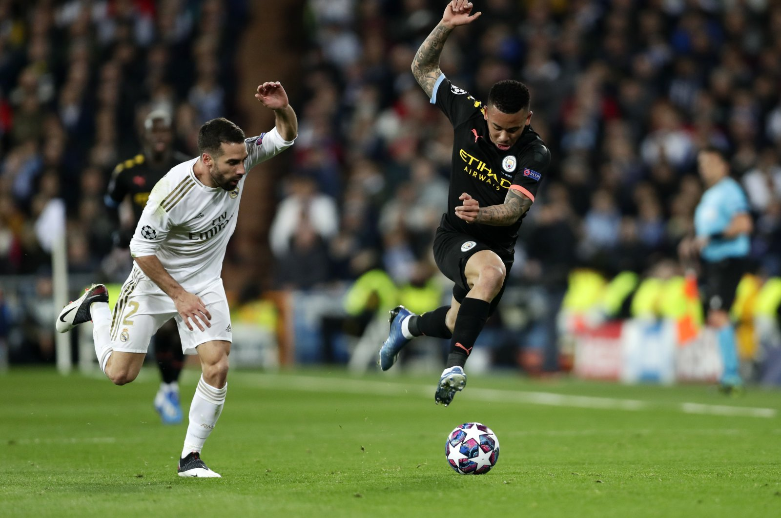 Manchester City's Gabriel Jesus (R) and Real Madrid's Dani Carvajal run for the ball during a Champions League round of 16 match in Madrid, Spain, Feb. 26, 2020. (AP Photo)
