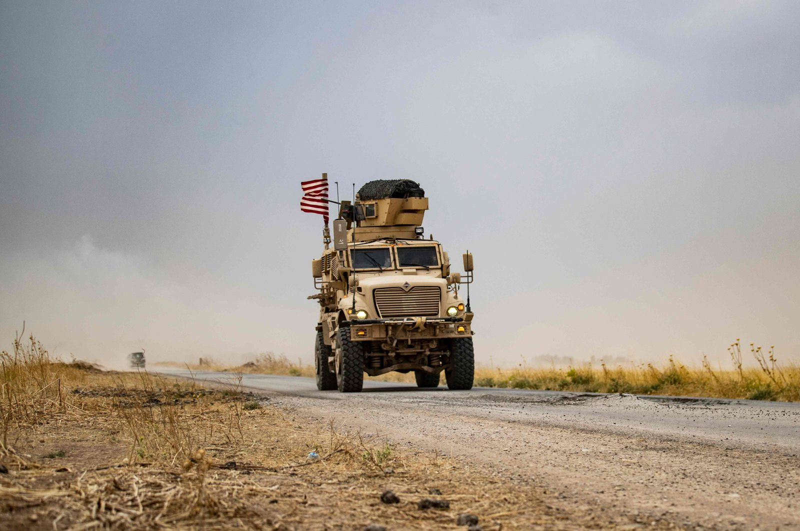 A U.S. military vehicle drives in the vicinity of an oil field in Rumaylan amid a sandstorm in Syria's northeastern Hasakeh province, July 1, 2020. (AFP Photo)