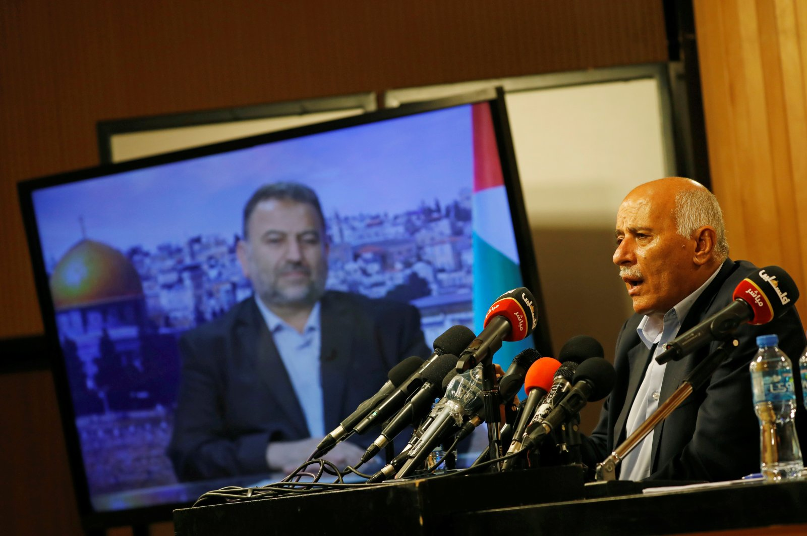 Senior Fatah official Jibril Rajoub speaks as deputy Hamas chief Saleh Arouri appears on a television screen during a videoconference to discuss Israel's plan to annex parts of the Israeli-occupied West Bank, in Ramallah, Palestine, July 2, 2020. (Reuters Photo)