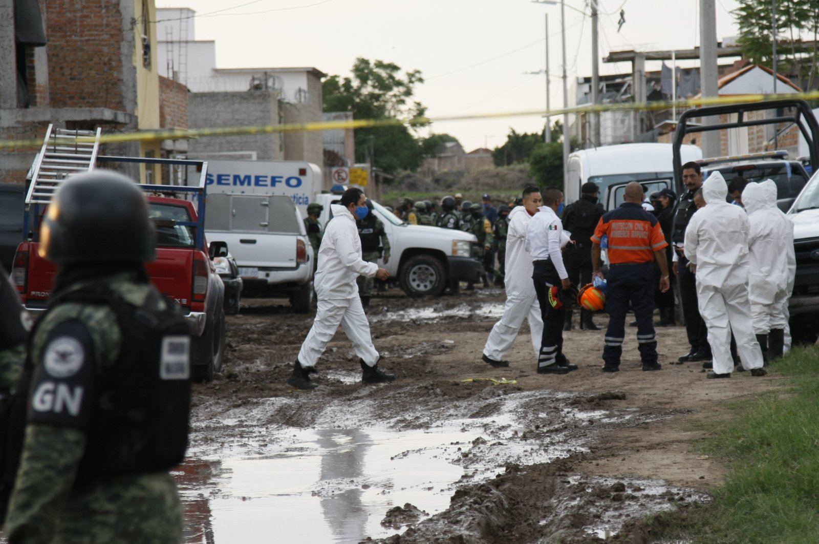 Members of the National Guard and forensic investigators work near a drug rehabilitation center in Irapuato, Mexico, July 1, 2020. (AP Photo)