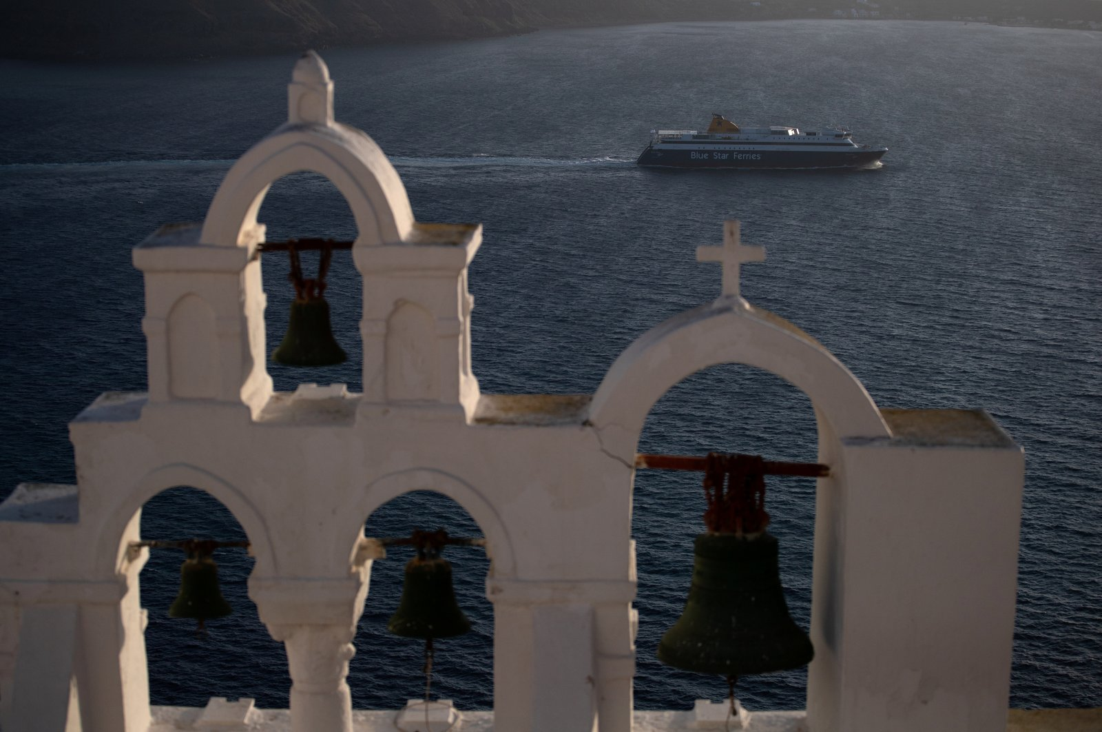 A ferry sails next to the caldera of Oia, following the outbreak of COVID-19, on the island of Santorini, Greece, May 6, 2020. (Reuters Photo)